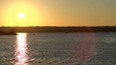 Sunset over water with ship Stock Footage