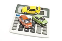 cars on calculator - stock photo