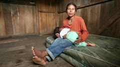 Mother with child living in very poor conditions, singing in quechua language, Stock Footage