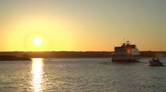 Ships in water at sunset slow motion Stock Footage