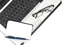 Laptop and agenda Stock Photos