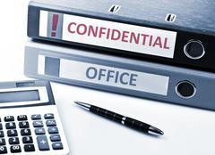 confidential write on folder - stock photo
