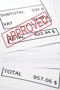 approved stamp on financial paper - stock photo