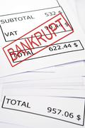 Bankrupt stamp on financial paper Stock Photos