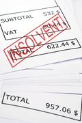 insolvent stamp on financial paper - stock photo