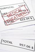 medical treatment stamp on financial paper - stock photo