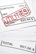 utilities stamp on financial paper - stock photo
