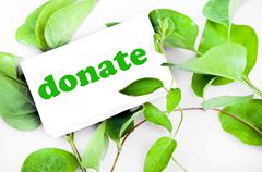 Stock Photo of donate message on leaves