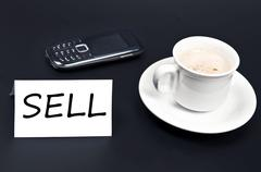 Sell message on desk with coffee Stock Photos