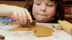 Little girl making gingerbread cookies Stock Footage