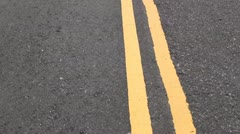 Moving yellow lines on the road Stock Footage
