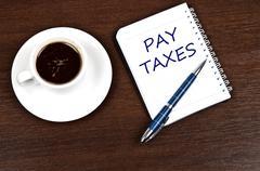 Pay taxes message Stock Photos