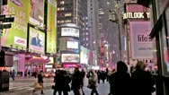Times Square People Walking Snowing Winter Manhattan New York City NYC USA Stock Footage