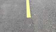 Close up of yellow lines in the road Stock Footage