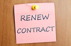renew contract post it - stock photo