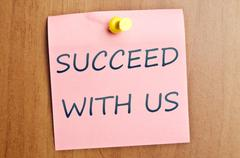 Succeed with us ad Stock Photos