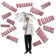 Failure word and business man with umbrella Stock Photos