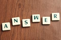 Answer word made by letter pieces Stock Photos