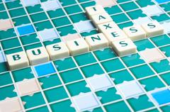 business and taxes word made by letter pieces - stock photo