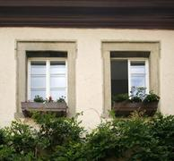 Stock Photo of house facade detail with two old windows