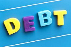 debt word on blue board - stock photo