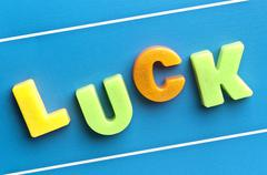 Stock Photo of luck word on blue board