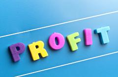 profit word on blue board - stock photo