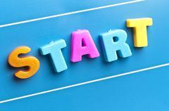 start word on blue board - stock photo