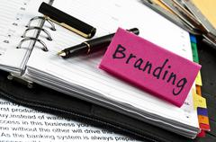 branding note on agenda and pen - stock photo