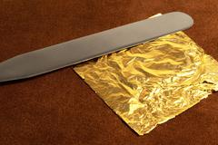 gold leaf and blade - stock photo