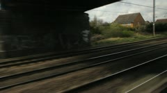 Train travel UK. Past flats. - stock footage
