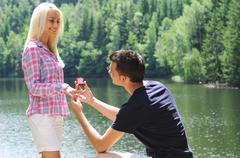 Young man proposal Stock Photos