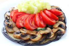 vegetables and mushrooms on white plate - stock photo