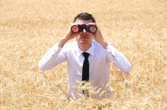 business man with binocular - stock photo