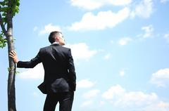 business man on sky - stock photo