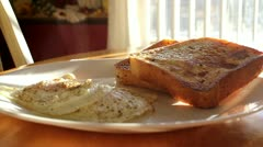 Yummy eggs and french toast breakfast with steam rising off plate - stock footage