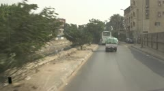 Drive plate, front Egypt Giza urban POV bus filthy canal, #1 Stock Footage