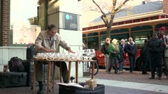 Man playing glass cups as instrument wide angle Stock Footage