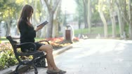 Girl and bench Stock Footage