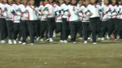 The Asian children lined up to enter the playground - stock footage