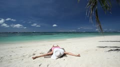 Woman relaxing on tropical beach Stock Footage