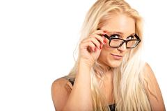 blonde woman adjusting her eyeglasses - stock photo