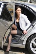 Businesswoman alighting from car Stock Photos