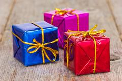 thre gifts on the wooden floor - stock photo