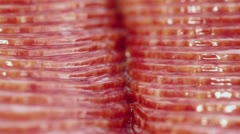 Vacuum packed slices of salami sausage circling closeup Stock Footage