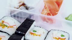 Set of Japanese sushi rolls, soy sauce, wasabi and ginger spins - stock footage