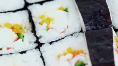 Set of delicious Japanese rolls spins closeup, view from above Stock Footage