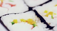Set of delicious Japanese rolls with rice circling closeup Stock Footage