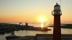 Lighthouse sunset aerial shot with drone Stock Footage
