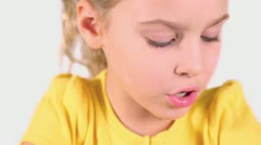 Little girl in yellow shirt reads syllable aloud isolated Stock Footage
